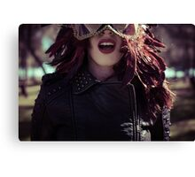 Sensual brunette woman with flowing hair and jacket with golden wings Canvas Print