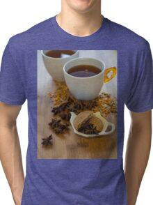 Tea, vegan cookies , and anise on wooden background Tri-blend T-Shirt