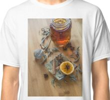 Tea,tea stainer, dried cinnamon, vegan cookies and anise on wooden background Classic T-Shirt