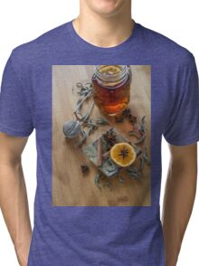 Tea,tea stainer, dried cinnamon, vegan cookies and anise on wooden background Tri-blend T-Shirt