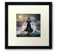 the forces of nature, blonde woman on the rocks with the sea raging and powerful Framed Print