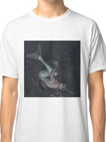 mermaid trapped in a sea of ​​mud, concept fantasy fish woman with beautiful blond hair and her body scales Classic T-Shirt