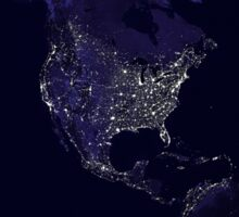 Full Earth at night showing city lights centered on North America. Sticker