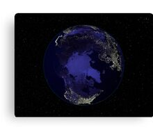 Full Earth at night showing city lights centered on the North Pole. Canvas Print
