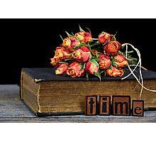 orange rose bouquet on vintage book Photographic Print