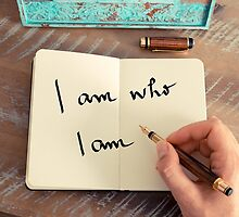 Motivational concept with handwritten text I AM WHO I AM by Stanciuc