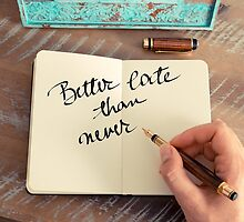 Motivational concept with handwritten text BETTER LATE THAN NEVER by Stanciuc