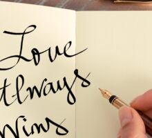 Motivational concept with handwritten text LOVE ALWAYS WINS Sticker