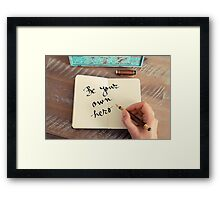 Motivational concept with handwritten text BE YOUR OWN HERO Framed Print