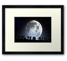 People by the moon Framed Print