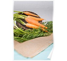 Carrots on a wooden table Poster