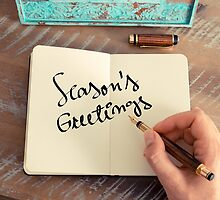 Motivational concept with handwritten text SEASON'S GREETINGS by Stanciuc