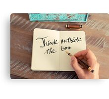 Motivational concept with handwritten text THINK OUTSIDE THE BOX Canvas Print
