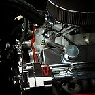 A beautiful sight of chrome. metal, and rubber ..Chevy engine  by jammingene