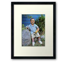 Boy and Favorite Toys Framed Print