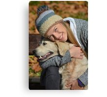 Smiling girl and retriever Canvas Print