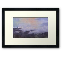 mountains in clouds Framed Print