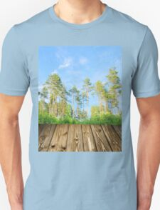 Pine forest in the summer with boards T-Shirt