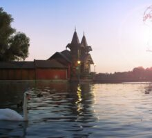 Beautiful view of the wooden house on an island on Lake Balaton. Sunset over the lake with swans Sticker