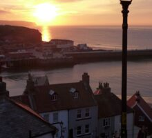 Whitby at sunset from the Abbey steps Sticker