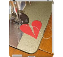 tailor try to sew two halves of broken heart together iPad Case/Skin