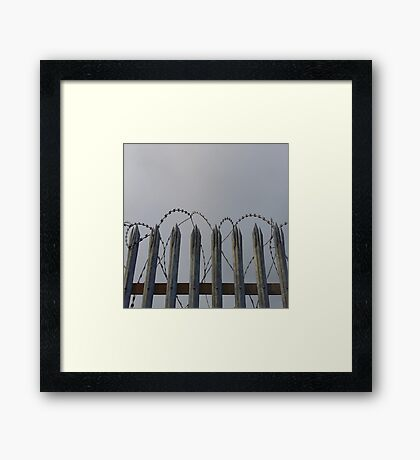 Razor-wire fence Framed Print
