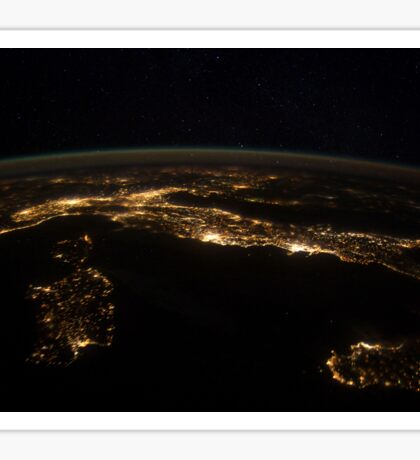 Nighttime panorama showing city lights of Europe. Sticker