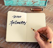 Motivational concept with handwritten text 10000 FOLLOWERS by Stanciuc