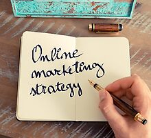 Motivational concept with handwritten text ONLINE MARKETING STRATEGY by Stanciuc