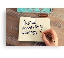 Motivational concept with handwritten text ONLINE MARKETING STRATEGY Canvas Print