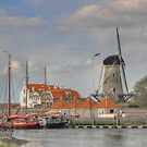 Boats, small houses and a mill .. that must be Holland by Thea 65