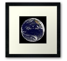 View of Earth showing three tropical cyclones in the Pacific Ocean. Framed Print
