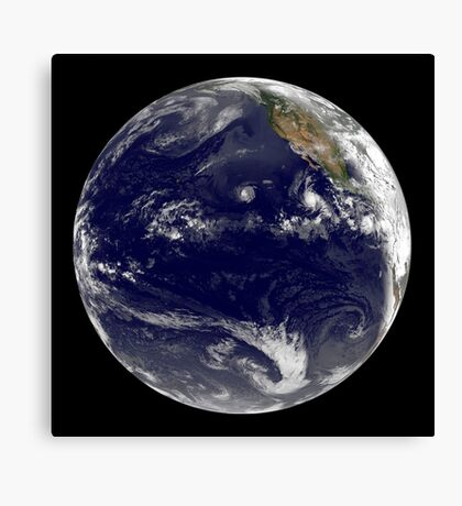 View of Earth showing three tropical cyclones in the Pacific Ocean. Canvas Print