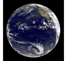 View of Earth showing three tropical cyclones in the Pacific Ocean. Photographic Print