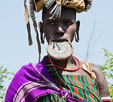 Woman of the Mursi tribe with clay lip disc by PhotoStock-Isra