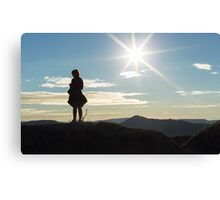 Silhouette woman on a mountain top Canvas Print