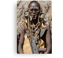 Woman of the Mursi with elongated lower lip to hold a clay disk as body ornament Canvas Print