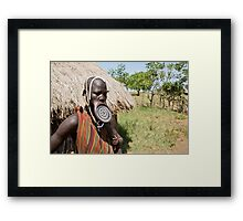 Woman of the Mursi tribe with clay lip disc as body ornaments Framed Print