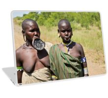 two women of the Mursi tribe with clay lip disc as body ornaments  Laptop Skin