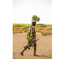 Nyangatom tribesman. Most adult males carry rifles. Omo Valley, Ethiopia  Photographic Print