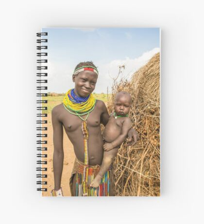 Young Nyangatom woman with baby in arms Spiral Notebook