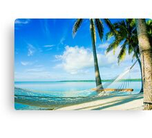 Empty hammock in warm tropical shade. Canvas Print