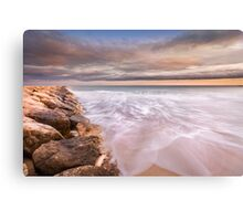 The tide and the breakwater Canvas Print