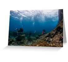 Divers explore natural caves and rocks in the Mediterranean sea off the coast of Larnaca, Cyprus,  Greeting Card