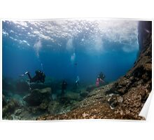 Divers explore natural caves and rocks in the Mediterranean sea off the coast of Larnaca, Cyprus,  Poster
