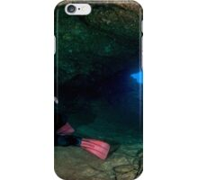 Divers explore natural caves and rocks in the Mediterranean sea off the coast of Larnaca, Cyprus,  iPhone Case/Skin