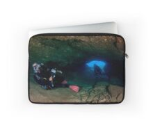 Divers explore natural caves and rocks in the Mediterranean sea off the coast of Larnaca, Cyprus,  Laptop Sleeve