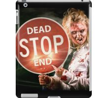 Halloween portrait. Scary zombie holding stop sign iPad Case/Skin