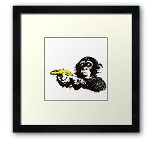 Monkey To Banana guns Framed Print