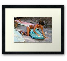 Woman Waxing a Surfboard Framed Print
